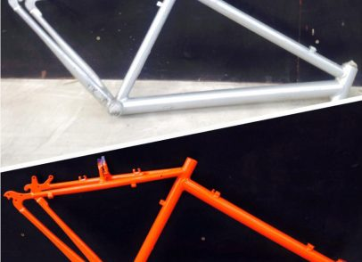 Bike frame was Aluminium blasted, powder primed and powder top coated orange